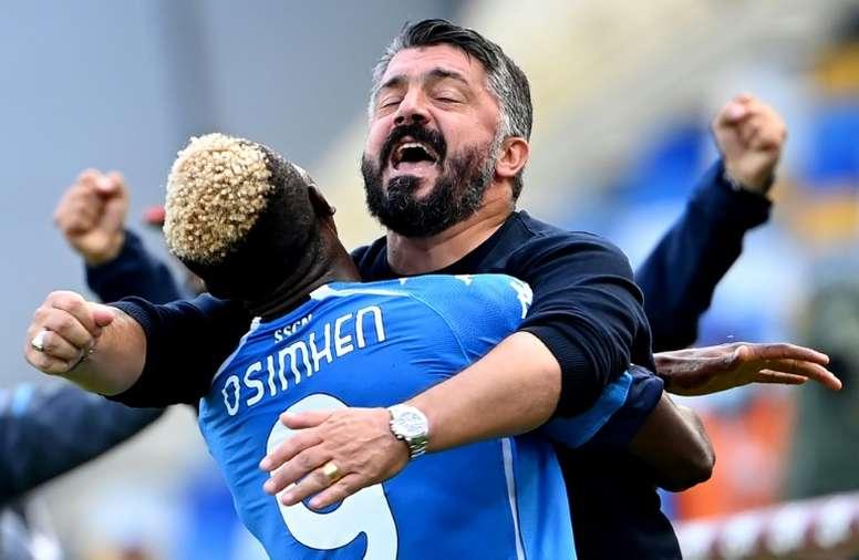 Nigerian forward Victor Osimhen celebrates with coach Gennaro Gattuso. AFP