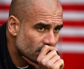 Guardiola says he is enjoying the challenge of battling for silverware. AFP