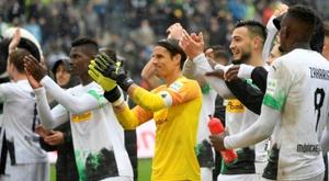 Moenchengladbach go top with Augsburg thrashing. AFP