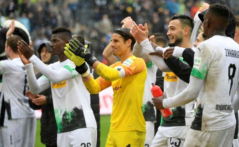 Moenchengladbach go top with Augsburg thrashing. AFP