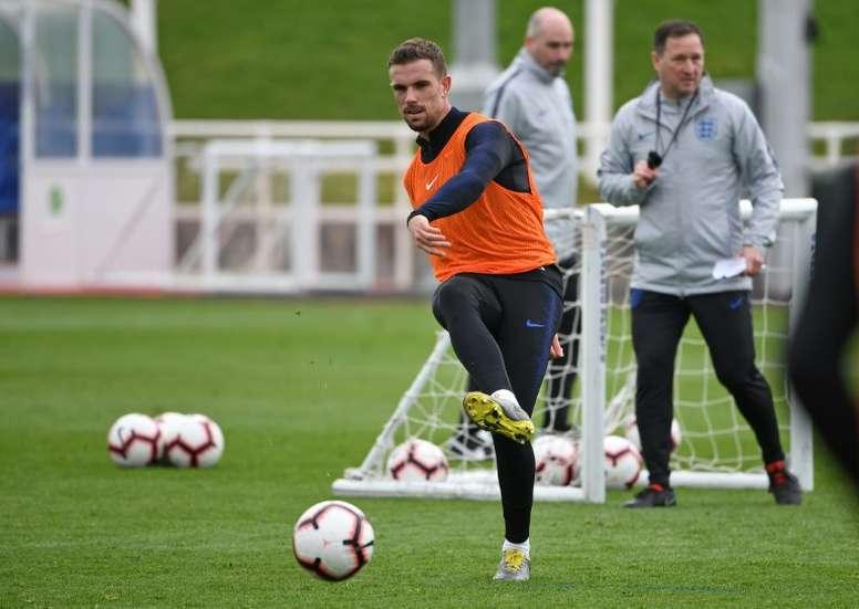 Henderson donne tout pour être présent contre l'Atlético. AFP