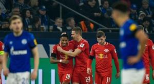 Halstenbervg (C) scored in Leipzig's 0-5 thumping of Schalke. AFP