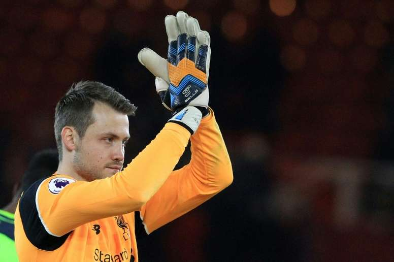 Liverpools goalkeeper Simon Mignolet applauds the fans following their English Premier League match against Middlesbrough, at Riverside Stadium in Middlesbrough, on December 14, 2016