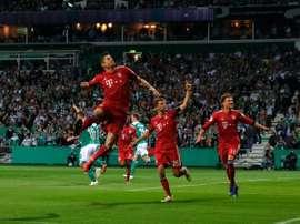Robert Lewandowski fired them to a 3-2 win over a valiant Werder Bremen. AFP