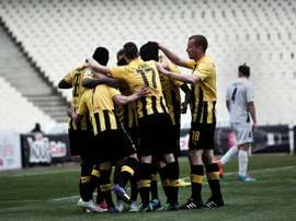 AEK Athens FC players celebrate a goal during a game in Athens on April 4, 2015