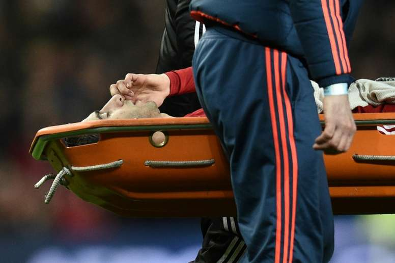 Mkhitaryan getting carried away in a stretcher. AFP