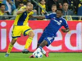 Maccabi Tel Aviv forward Tal Ben Haim II is tackled by Chelseas Abdul Baba Rahman. AFP