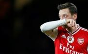 China media warns Arsenal of 'serious implications' over 'clownish' Ozil. AFP