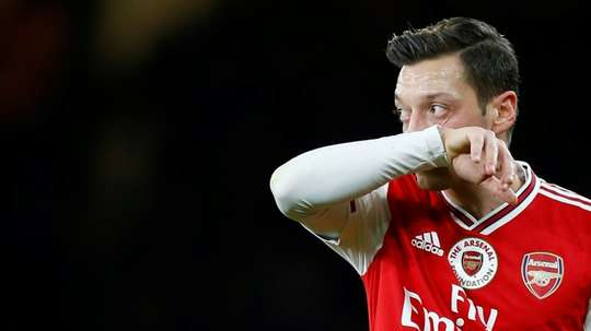 China media warns Arsenal of 'serious implications' over 'clownish' Ozil. AFP