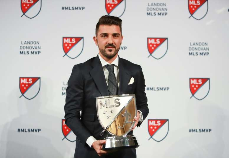 David Villa of New York City FC poses for a photo with the 2016 Landon Donovan MLS MVP trophy. AFP