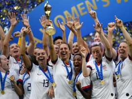 Victorious US women's team back on home soil