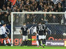 Lyons Emanuel Mammana (L) scores a late goal during their match against Bordeaux