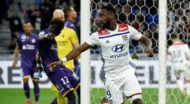 Former Celtic striker Dembele scored twice as Lyon thrashed Toulouse. AFP