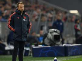 Interim coach Hansi Flick will remain in charge of Bayern Munich . AFP