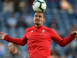 Lovren is being linked with a move to Serie A. AFP