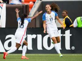 Crystal Dunn (L) celebrates with Alex Morgan after Morgan of the US Womens National Team scored during the second half of a friendly match against Japan on June 5, 2016 in Cleveland, Ohio