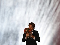 Real Madrid and Croatia midfielder Luka Modric kisses the trophy. AFP