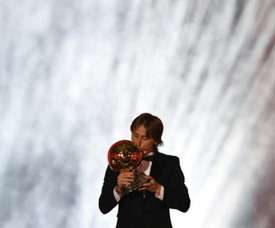 Real Madrid and Croatia midfielder Luka Modric kisses the trophy. AFP