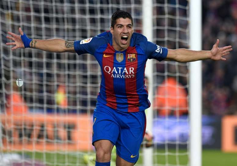 Barcelonas forward Luis Suarez celebrates a goal during the Spanish league football match against Real Madrid CF December 3, 2016