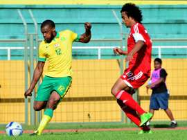 South African Bafana Bafana player Wamdisile Letlabika (L) fights Mauritius Club M player Perticots Kevin Joseph for possession during their 2016 African Nations Championship qualifier on July 5, 2015 in Mauritius