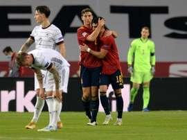 Ferran Torres (R) scored three as Spain thrashed Germany 6-0. AFP