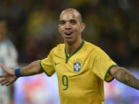 Tardelli has been banned for rubbing his face during the Chinese national anthem. AFP