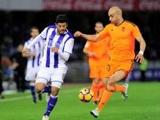 Real Sociedads forward Carlos Vela (L) vies with Valencias Tunisian defender Aymen Abdennour (R) during the Spanish league football match December 10, 2016