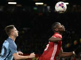 Maffeo keeps a close eye on Paul Pogba in the EFL Cup clash between Man City and Man Utd. AFP