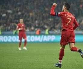Ukraine qualify for Euro 2020 despite Ronaldo's 700th goal. AFP