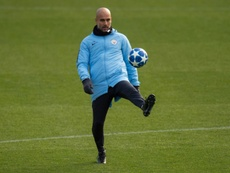 Guardiola has warned his City side against complacency. AFP