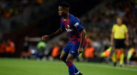Fati starts over Messi. AFP