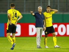 Lucien Favre (C) is not happy at travelling to Rome to face Lazio during COVID-19 pandemic. AFP