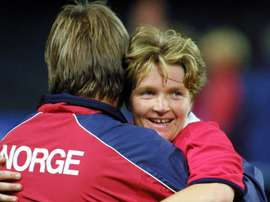 Hege Riise (right) is to lead a training camp for England Women. AFP