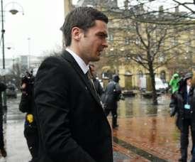 Former Sunderland footballer Adam Johnson (C) arrives at Bradford Crown Court in Bradford, northern England, on March 2, 2016