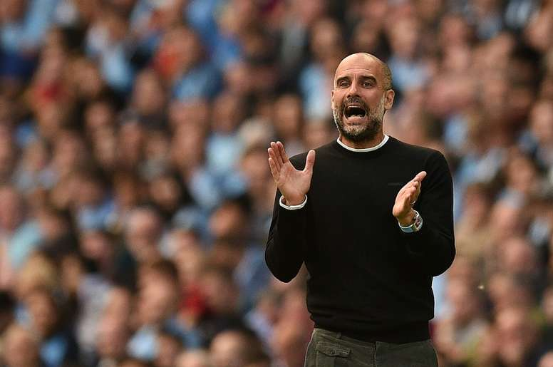 Neville believes that City are hiding their situation, ready to pounce in January. AFP