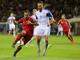 Spains forward Paco Alcacer (L) vies with Luxembourgs defender Maxime Chanot during the Euro 2016 qualifying football match at Las Gaunas stadium in Logrono on October 9, 2015