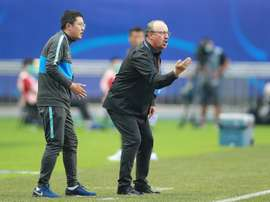 Benitez, van Bronckhorst plunged into China basement scrap. AFP