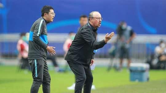 Benitez, van Bronckhorst plunged into China basement scrap. AFP