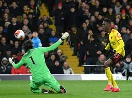 Liverpool want Ismaila Sarr (R) from Watford. AFP