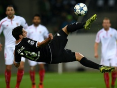 Moenchengladbachs midfielder Lars Stindl kicks the ball during a UEFA Champions League match against Sevilla in Moenchengladbach, western Germany on November 25, 2015