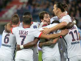 Paris Saint-Germains forward Angel Di Maria (2rd R) celebrates with teammates after scoring a goal during the French L1 football match between Caen and Paris Saint-Germain on December 19, 2015 in Caen, France