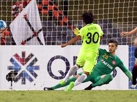 Shinzo Koroki of Urawa Red Diamonds scores past Western Sydney Wanderers goalkeeper Vedran. AFP