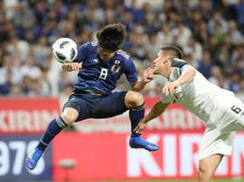 Japan's midfielder Takumi Minamino pictured scoring for Japan. AFP