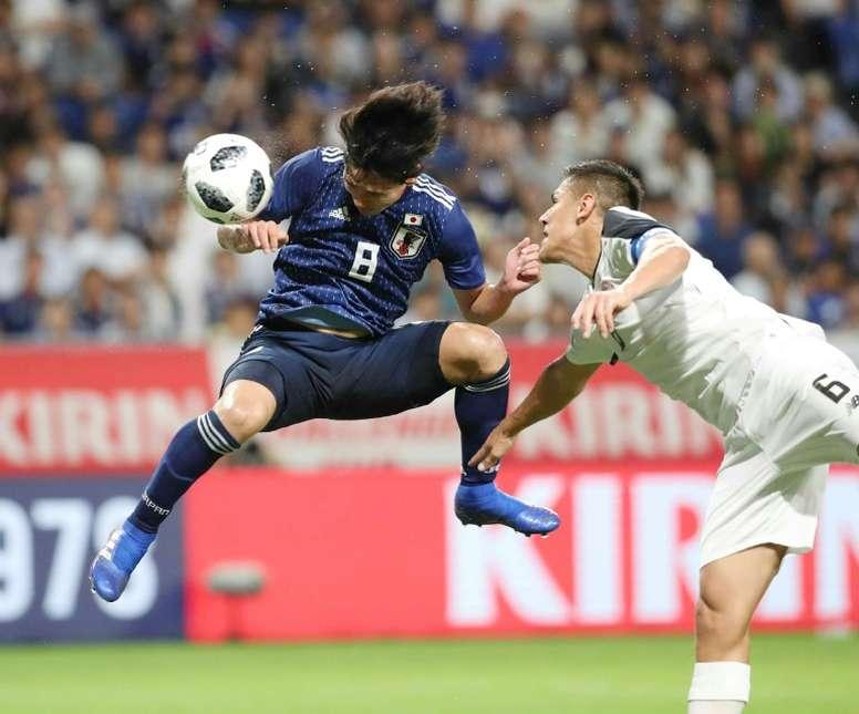 Japan's midfielder Takumi Minamino pictured scoring for Japan. AFP