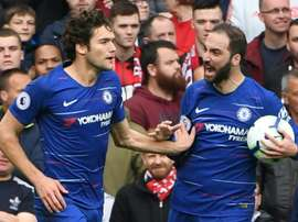 Higuain celebrating with Marcos Alonso. AFP