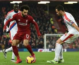 Salah brilhou e Firmino fez história. AFP