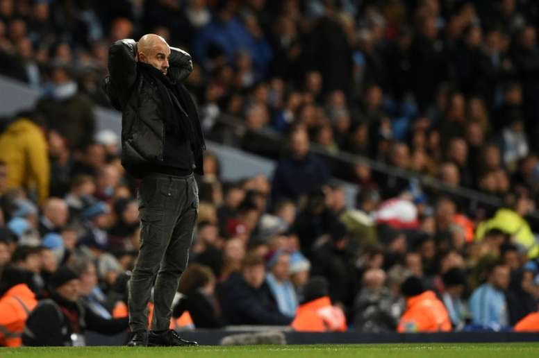 Guardiola claims Man City a victim of their own success. AFP