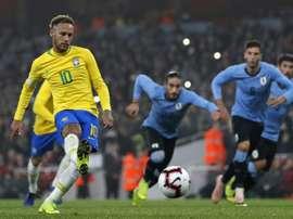 Brazil's Neymar scores the winner against Uruguay. AFP