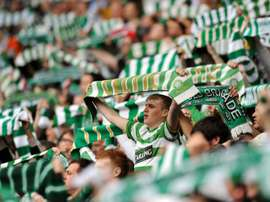 Celtic supporters sing before a match at Celtic Park in Glasgow, Scotland on May 24, 2009