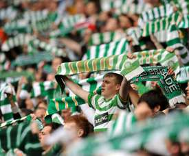 Celtic supporters sing before a Scottish Premier League football match at Celtic Park in Glasgow, Scotland